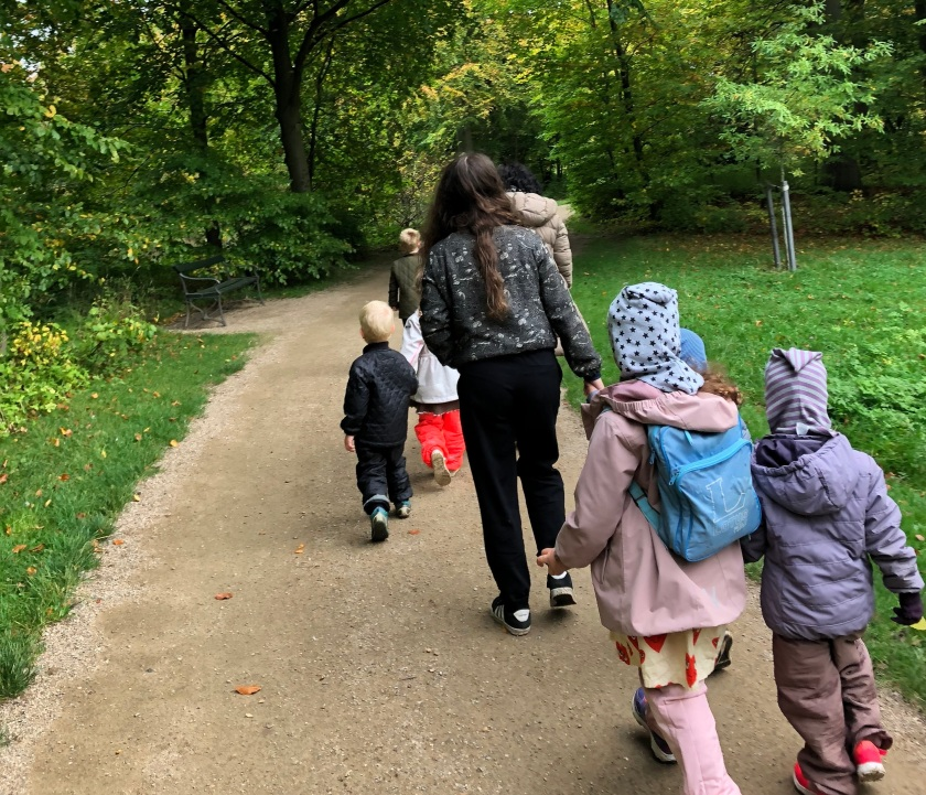 Female educator and young children from Kensington Community Children's Co-operative on a nature walk